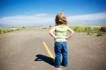 Photo of girl looking at empty road